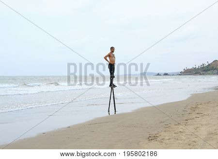 Goa India - February 28 2015: Unidentified man dancing on the stilts.