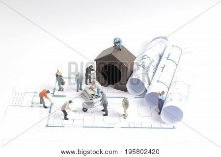 Building House On Blueprints With Worker Construction