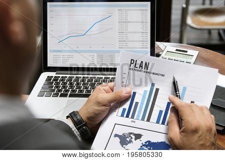 Businessman checking business data and bars