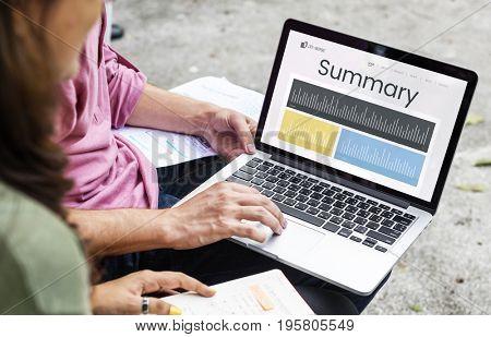 Summary graphs on laptop screen