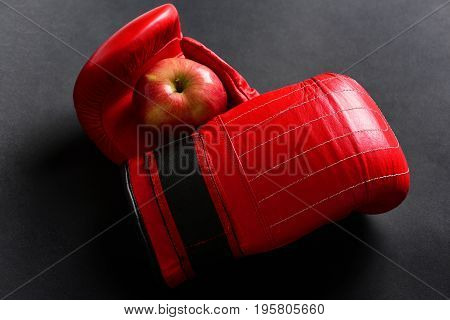 Boxing Gloves In Red. Sport Equipment And Fruit On Black