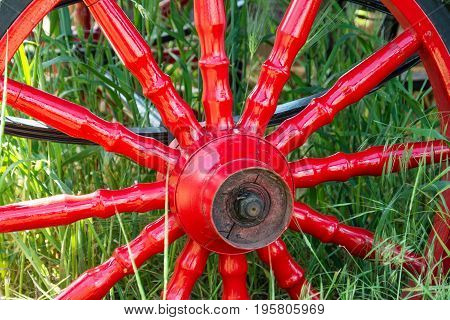 Red Metal Vintage Wheel From The Carriage Close-up.