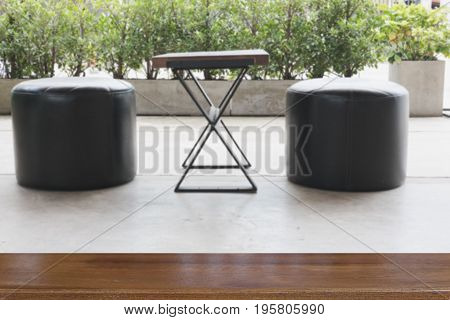 Wood Desk And Leather Stool Chair At Terrace On Patio With Wood Table For Display Your Product