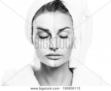 Beautiful woman with mask on her face isolated on white background. Skincare concept.