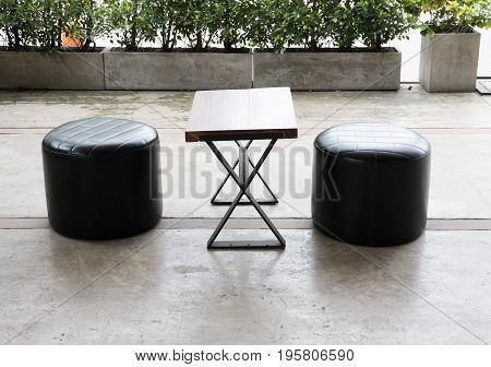 Wood Desk And Leather Stool Chair At Terrace On Patio