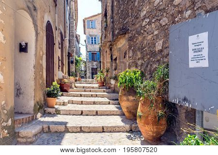 St Paul de Vence, France - June 30, 2016: typical narrow street with tourists in St Paul de Vence France. It is a popular destination for a large number of artists poets and writers.