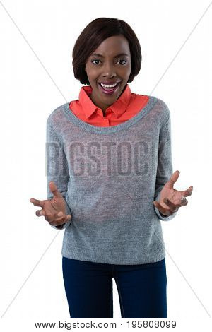 Portrait of surprised young woman gesturing while standing against white background