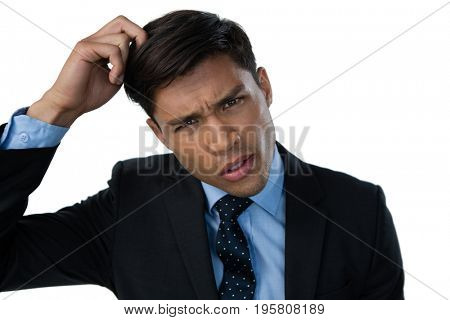 Portrait of confused businessman with hand in hair