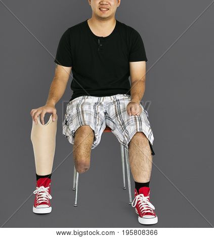 Disability Young Man with Prosthesis Leg Studio Portrait