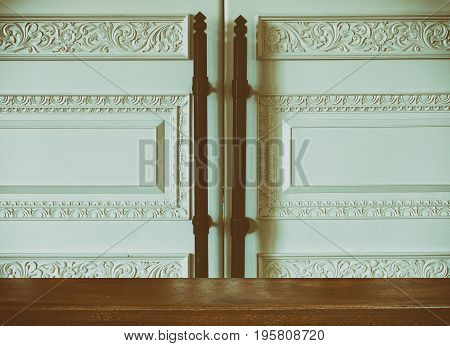 vintage retro style white door with carved wooden design and decoration with wood table for montage or display your product