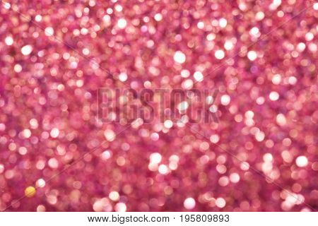 Pink festive background with sparkles in the bokeh. The concept of the celebration the day of St. Valentine New Year birthdays ceremonies events etc.
