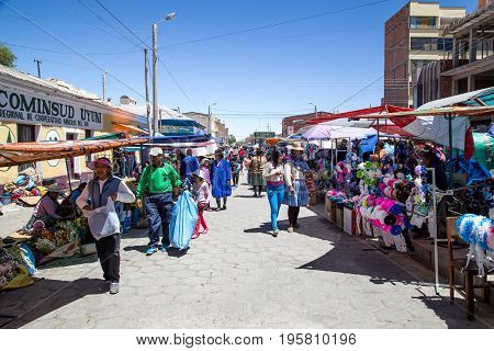 Uyuni, Bolivia - October 31, 2015: People selling and buying at the local market