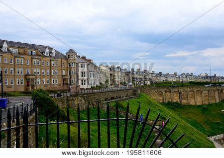Historic town of Tynemouth in England on a cloudy day