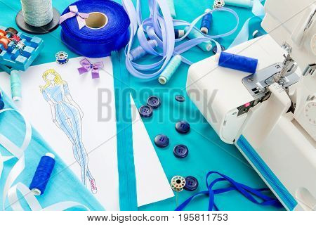 Dressmaker's workplace: sketch of costume ribbons spools buttons fabric and sewing machine