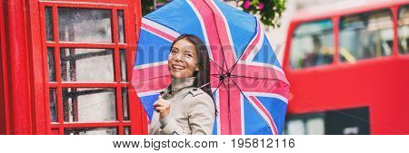 London tourist travel woman banner panorama with copyspace, europe famous city vacation. Asian girl with british icons, red telephone box, big bus.
