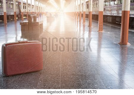 Old Red Suitcase, Baggage Or Luggage On Platform At Train Station. Journey, Trip, Travel Concept