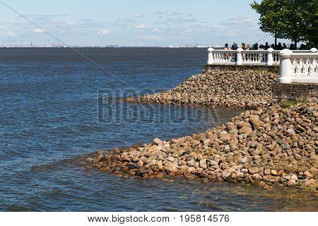 St. Petersburg, Russia - June 28, 2017: Embankment With Stone Banks And White Railings. Peterhof In