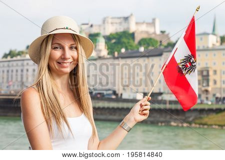 Female Tourist On Vacation In Salzburg Austria Holding The Austrian Flag
