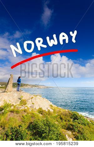 Woman Tourist Looking At Ocean In Norway