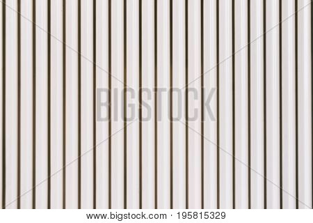 Metal ribbed texture Profile decking. Internal primed side of a metal picket fence