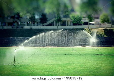 Lawn watering, watering sports ground in hot summer days