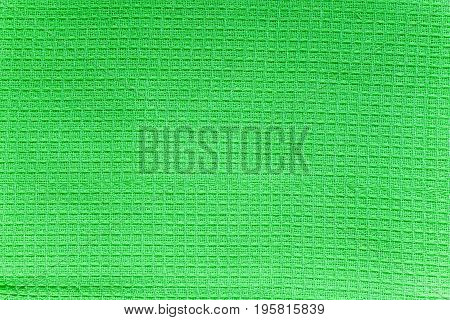 Texture of green cotton waffle towels closeup