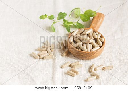 Herbal capsules from herbs on wooden table,Close-up shots of capsules