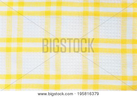 White and yellow checked cotton fabric texture closeup