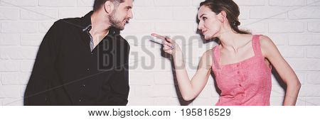 Stylish Playful Woman Pointing Finger
