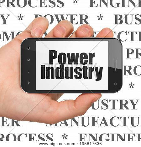 Manufacuring concept: Hand Holding Smartphone with  black text Power Industry on display,  Tag Cloud background, 3D rendering
