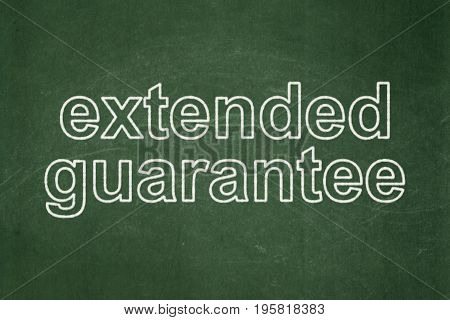 Insurance concept: text Extended Guarantee on Green chalkboard background