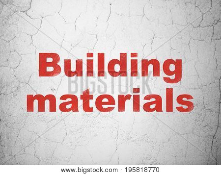 Building construction concept: Red Building Materials on textured concrete wall background