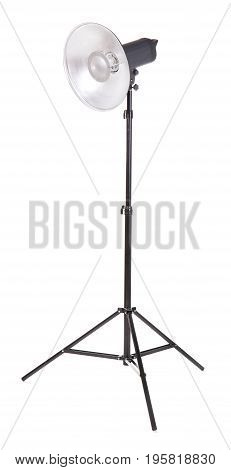 Professional studio flashlight, isolated on a white background. Photographic studio light with a tripod. A reflector, an outbreak on a tripod. Photo equipment.