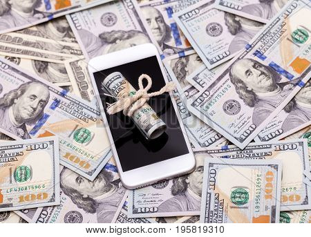 Dollars are on the phone. Concept on business and bribes