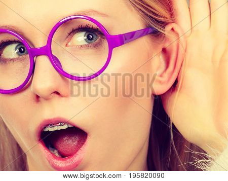Woman Listening Carefully With Hand Close To Ear