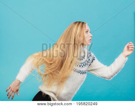 Woman With Long Blonde Hair Running