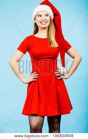 Xmas seasonal clothing winter christmas concept. Young smiling positive woman wearing Santa Claus helper costume