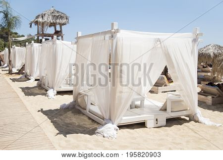 The vacant white canopies on a beach