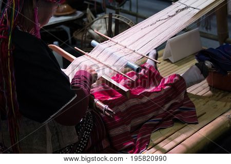 CHIANG MAI, THAILAND - JULY 1: old woman weave traditional Thai fabric textile at Lanna Expo 2017 in Chiang Mai Thailand on July 1 2017.
