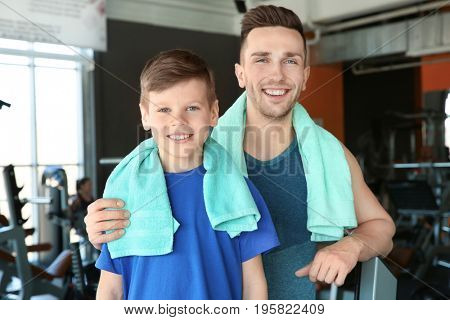 Dad and son in gym