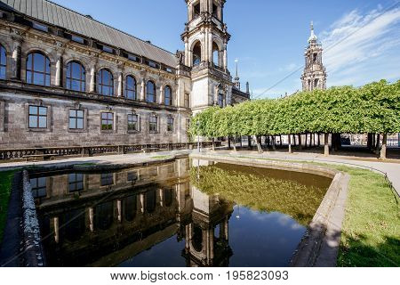 Morning view on the Court of Appeal building with fountain on the Bruhl terrace in Dresden city, Germany