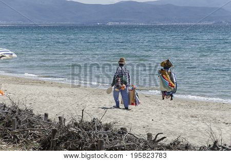 Follonica Italy - September 09 2015: African sellers on the beach