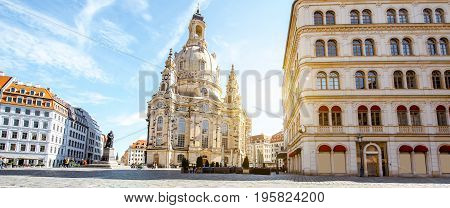 Panoramic view on the main city square with famous church of Our Lady during the sunrise in Dresden city, Germany