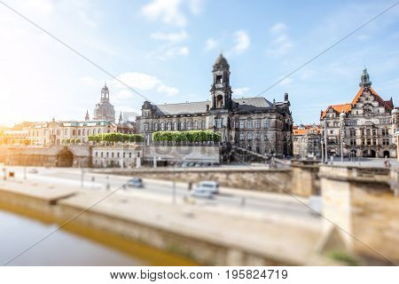 View on the riverside of Elbe river with beautiful buildings and church dome during the sunny weather in Dresden city, Germany. Tilt-shift image technic