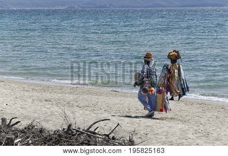 Follonica Italy - September 09 2015: Two African sellers on the Italian beach