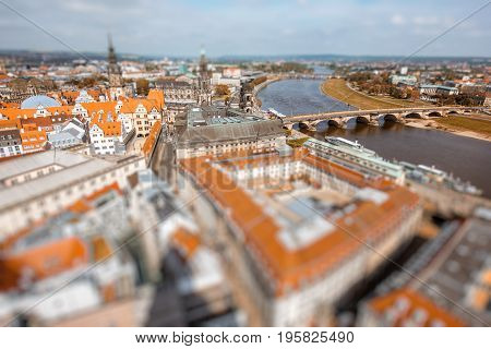 Aerial cityscape view on the old town of Dresden city in Germany. Tilt-shift image technic