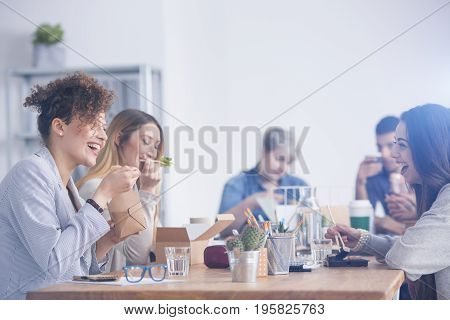 Caucasian Employees Eating Lunch