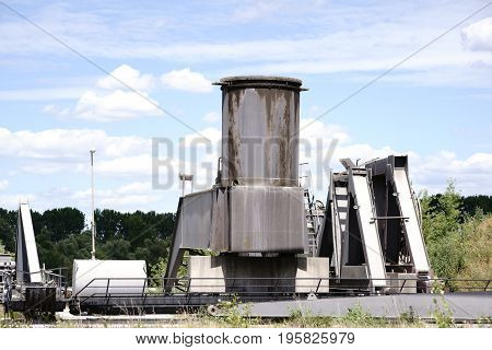 Boilers silos and equipment for cement production on an industrial site.