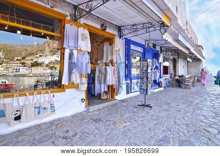 HYDRA ISLAND GREECE, MAY 27 2016: shops with clothes and souvenirs at Hydra island Saronic Gulf Greece. Editorial use.