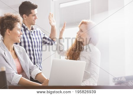 Business Colleagues Giving High Five